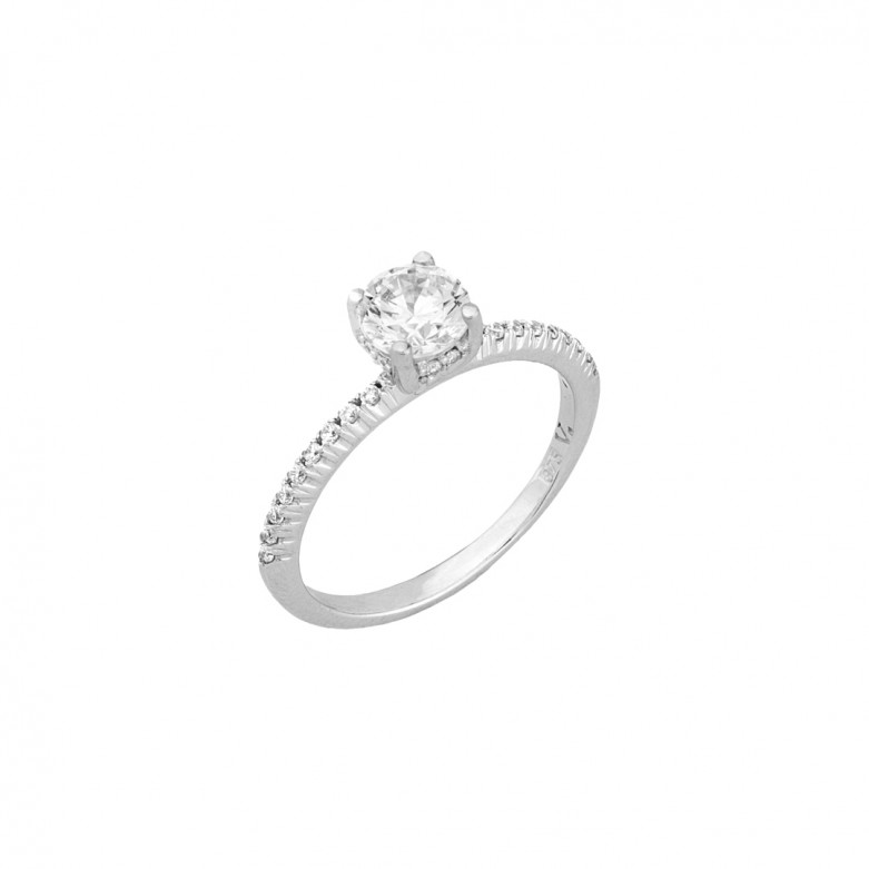 9kt Gold. Solitaire in 9ct white gold with CZ band