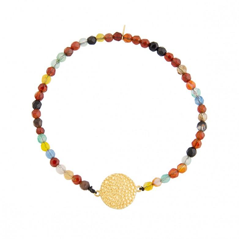 Sterling silver 925°.  Hammered disc on multicoloured bracelet