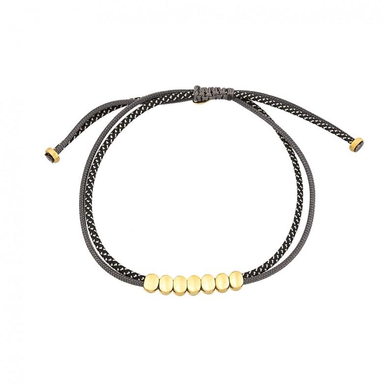 9kt Gold. Seven oval bead bracelet on cord