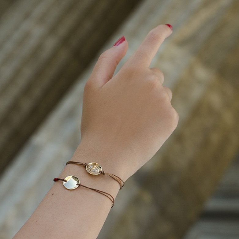 Sterling silver 925°.  Gold disc on cord bracelet