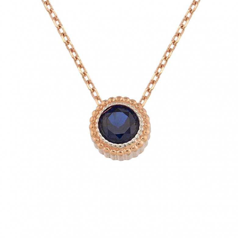 Sterling silver 925°. Round pendant with blue CZ